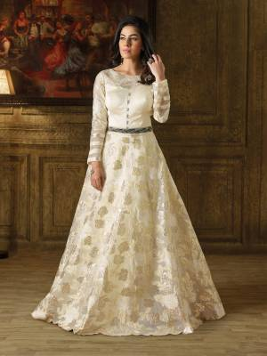 Simple And elegant Looking Floor Length Gown Is Here In Off-White Color which Is Made On Imported Fabric Which Beautified With Self Work And Embellishment.
