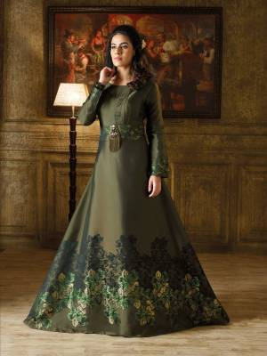 New And Unique Shade In Green Is Here With This Designer Floor Length Gown In Forest Green Color Based On Imported Fabric. It Has Lovely Self Prints And A Broach Over The Belt.