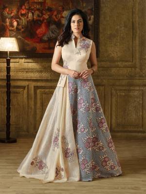 Add  This Pretty Gown To Your Wardrobe In Cream And Grey Color Fabricated On Imported Fabrics. This Designer Floor Length Gown Has Beautiful Two Layered Pattern. Buy This Pretty Gown Now.