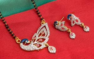 Grab This Designer Heavy Mangalsutra In Golden Color Beautified With Diamonds All Over. This Mangalsutra Comes With A Set Of Matching Earrings. It Is Light In Weight And Easy To Carry Throughout The Gala.  Buy Now.