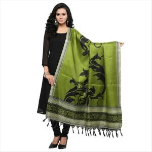 Simple And Elegant Looking Dupatta Is Here In Green Color Fabricated On Cotton Art Silk Beautified With Bold Printed Motif. It Can Be Paired With Green, Black Or White Colored Suit.