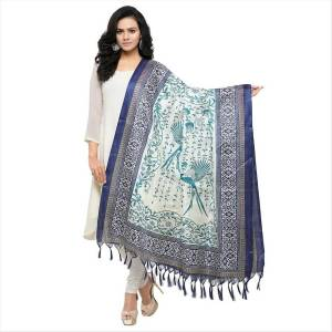 Very Pretty, Simple And Elegant Looking Dupatta Is Here In White and Blue Color Fabricated On Cotton Art Silk Beautified With Prints All Over It. It Is Light Weight And Can Be Paird With Any Contrasting Or White Colored Suit. Buy Now.