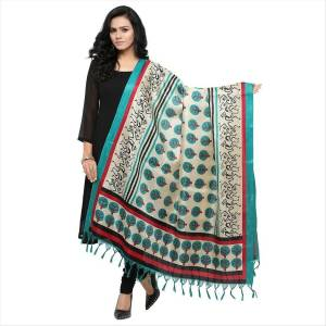 Very Pretty, Simple And Elegant Looking Dupatta Is Here In White and Turquoise Blue Color Fabricated On Cotton Art Silk Beautified With Prints All Over It. It Is Light Weight And Can Be Paird With Any Contrasting Or White Colored Suit. Buy Now.