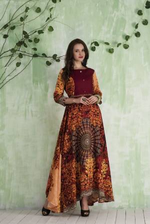 Grab This Attractive Patterned Floor Length Readymade Gown In Maroon And Multi Color Fabricated On Tussar Art Silk Beautified With Prints All Over. It Is Light Weight And Easy To Carry All Day Long.