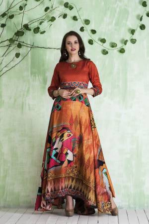 Shine Bright Wearing This Readymade Floor Length Gown In Orange And Multi Color Fabricated On Tussar Art Silk Beautified With Prints All Over.
