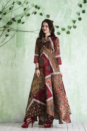 Here Is Pretty Readymade Floor Length Gown In Brown And Multi Color Fabricated On Tussar Art Silk Beautified With Prints All Over It. Its Fabric Is Soft Towards Skin And Easy To Carry All Day Long.