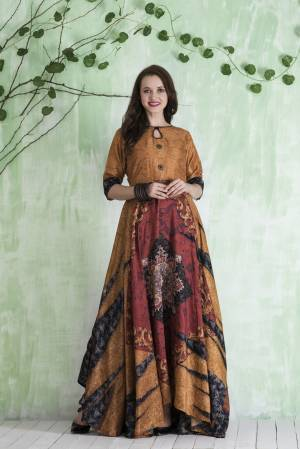 Earn Lots Of Compliments Wearing This Readymade Floor Length Gown In Beige And Multi Color Fabricated On Tussar Art Silk Beautified With Prints All Over It. Buy This Gown Now.