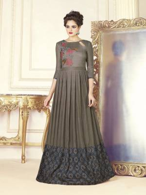 Elegant Looking Designer Floor Length Gown Is Here In Grey Color Fabricated On Soft Silk. This Pretty Readymade Gown Is Beautified With Prints And Thread Work. It Is Light In Weight And Easy To Carry All Day Long. Buy Now.