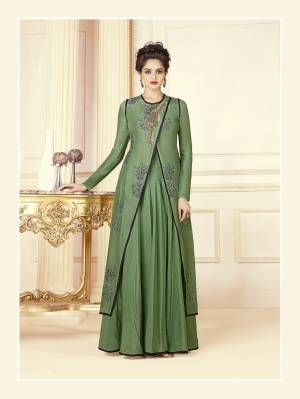 New And Unique Patterned Designer Readymade Gown Is Here In Green Color Fabricated On Cotton Blend. This Indo-Western Gown Is Beautified With Embroidery.  Buy This Now.