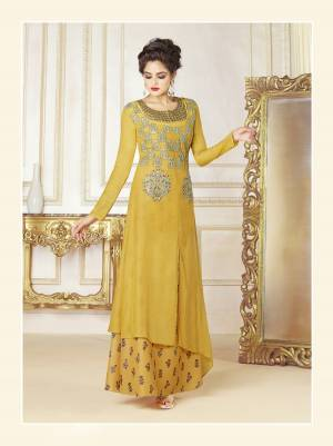 Celebrate This Festive Season Wearing This Designer Readymade Gown In Yellow Color Fabricated On Cotton Blend. This Pretty Gown Is Beautified With Prints And Embroidery. Buy This Lovely Gown Now.