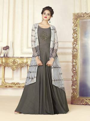 Flaunt Your Rich And Elegant Taste Wearing This Designer Readymade Gown In Grey Color. Its Top Is Fabricated On Cotton Blend Paired With Chanderi Cotton Fabricated Printed Jacket. It Has An Attractive Pipe Work Patch Over The Front. Buy This Designer Indo-Western Dress Now.