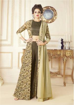 You Will Definitely Earn Lots Of Compliments Wearing This Designer Indo-Western Dress In Brown And Cream Color. Its Blouse Is Fabricated On Printed Satin Paired With Art Silk Fabricated Pant And Cotton Blend Printed Jacket.  Buy This Lovely Dress Now.