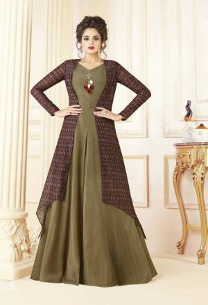 Here Is A Beautiful Designer Readymade Gown Suitable For All Occasion. Grab This Designer Gown In Olive Green Color With Multi Colored Jacket. It Is Cotton Blend Fabricated With Chanderi Cotton Fabricated Jacket. Buy This Gown Now.