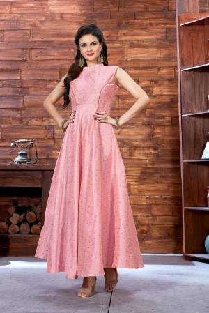 Look Pretty Wearing This Lovely Readymade Gown In Light Pink Color Fabricated On Art Silk Beautified with Prints. This Pretty Gown Is Light In Weight And Easy To Carry All Day Long.