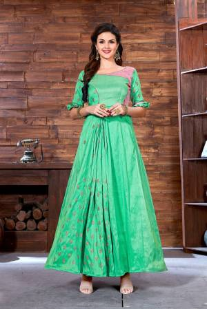 Celebrate This Festive Season Wearing This Designer Floor Length Readymade Gown In Light Green Color Fabricated On Art Silk. This Gown Is Beautified With Jari Work With A Lovely Two Colored Pattern.