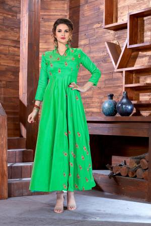 Simple And Elegant Looking Designer Readymade Gown Is Here In Green Color Fabricated On Art Silk Beautified With Jari And Thread Small Floral Motifs.