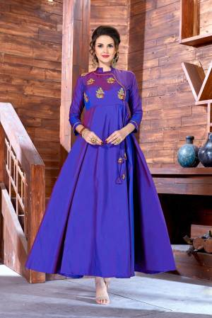 Bright And Visually Appealing Color Is Here With This Designer Floor Length Readymade Gown In Violet Color Fabricated On Art Silk. It Has Embroidered Motifs Over The Yoke. Buy Now.