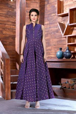 You Will Definitely Earn Lots Of Compliments Wearing This Designer Floor Length Readymade Gown In Dark Purple Color Fabricated On Art Silk. It Has Pretty Small Embroidred Motifs All Over It. Buy Now.