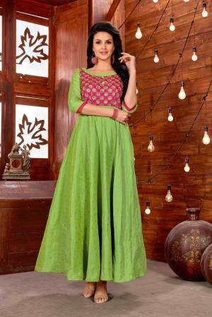Celebrate This Festive Season Wearing This Designer Readymade Gown In Green Color Fabricated On Art Silk. It Has Lovely Embroidered Yoke In Pink Color. Buy This Readymade Gown Now.