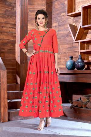 Look Attractive Wearing This Designer Floor Length Gown In Orange Color Fabricated On Art Silk. This Pretty Gown Ensures Superb Comfort Throughout The Gala.