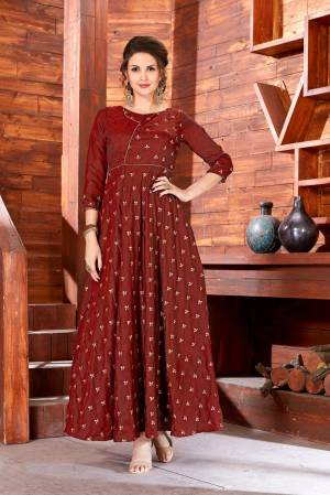 Flaunt Your Rich And Elegant Taste Wearing This Designer Floor Length Readymade Gown In Brown Color Fabricated On Art Silk Beautified With Jari Embroidered Small Motifs All Over It. This Simple And Elegant Looking Dress Will Earn You Lots Of Compliments From Onlookers.