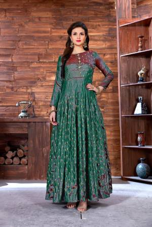New And Unique Shade Is Here With This Designer Floor Length Gown In Teal Green Color Fabricated On Art Silk. Its Fabric Ensures Superb Comfort Throughout The Gala. Buy Now.