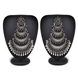 Grab This Common Color That Goes With All. Pair This Attractive Pair Of Earrings In Silver Color Beautified With Black Colored Stones With Any Colored Ethnic Attire. These Pair Of Earrings Will earn You Lots Of Compliments From Onlookers.