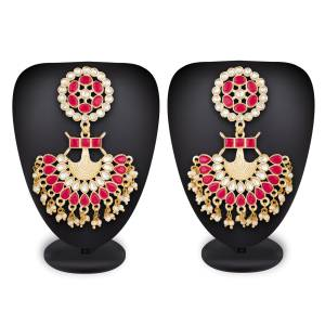 For That Lovely Pink Dress, Grab This Lovely Pair Of Earrings In Golden Color Beautified With Pink And White Colored Stone Work. Buy This Lovely Pair Now.