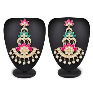 You Will Definitely Earn Lots Of Compliments Wearing This Lovely Pair Of Earrings In Golden Color Beautified With Stone Work.