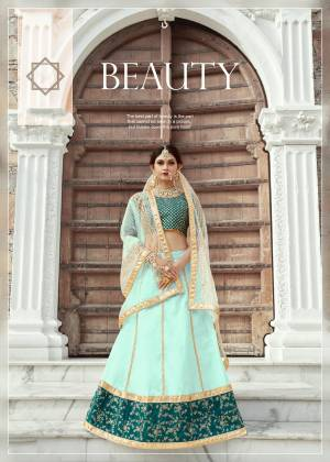 Featuring An Aqua Colored art silk lehenga with zari work and sequins work on hem. It comes along with a Teal Blue blouse in art silk base with shot sleeves featuring heavy zari and sequins embroidery on whole blouse. It has a soft net dupatta with seuqins lining.