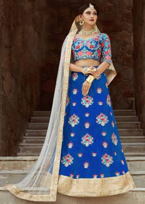 Posh and alluring, this faroese art silk kalidaar style lehenga is highlighted with resham and pearl embroidery. It comes along with an embroidered sweetheart neck butta work blouse. Styled up with off white embroidered dupatta.