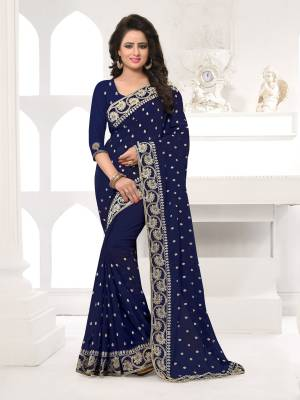 Featuring An Eye Catching design with This Beautiful Designer Saree In Navy Blue Color Paired With Navy Blue Colored Blouse. This Saree And Blouse are Fabricated On Georgette Beautified With Attractive Embroidery. This Pretty Design Is Available In Many Colors.