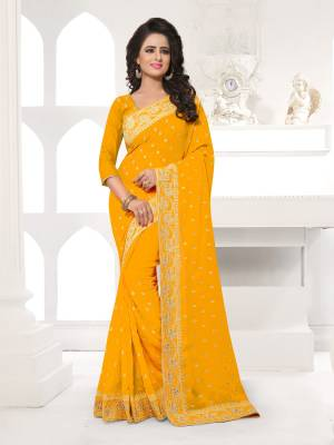 Featuring An Eye Catching design with This Beautiful Designer Saree In Orange Color Paired With Orange Colored Blouse. This Saree And Blouse are Fabricated On Georgette Beautified With Attractive Embroidery. This Pretty Design Is Available In Many Colors.