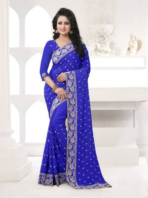 Featuring An Eye Catching design with This Beautiful Designer Saree In Royal Blue Color Paired With Royal Blue Colored Blouse. This Saree And Blouse are Fabricated On Georgette Beautified With Attractive Embroidery. This Pretty Design Is Available In Many Colors.