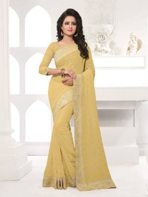 Featuring An Eye Catching design with This Beautiful Designer Saree In Beige Color Paired With Beige Colored Blouse. This Saree And Blouse are Fabricated On Georgette Beautified With Attractive Embroidery. This Pretty Design Is Available In Many Colors.