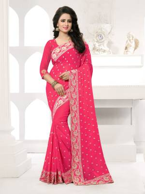 Featuring An Eye Catching design with This Beautiful Designer Saree In Fuschia Pink Color Paired With Fuschia Pink Colored Blouse. This Saree And Blouse are Fabricated On Georgette Beautified With Attractive Embroidery. This Pretty Design Is Available In Many Colors.