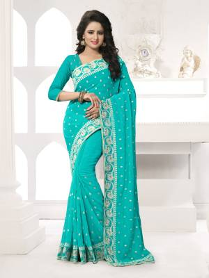 Featuring An Eye Catching design with This Beautiful Designer Saree In Turquoise Blue Color Paired With Turquoise Blue Colored Blouse. This Saree And Blouse are Fabricated On Georgette Beautified With Attractive Embroidery. This Pretty Design Is Available In Many Colors.