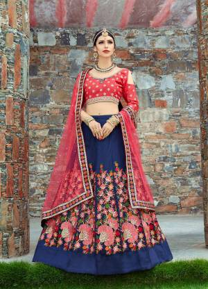 Featuring a Dark Blue Colored lehenga in mulbari silk base with floral embroidery at the bottom. It is paired with a pink sweetheart neck embroidery blouse with flower work embroidered dupatta.