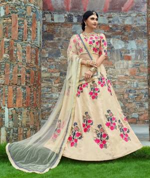 This set options a cream flared kalidaar lehenga skirt in art silk base with pink floral embroidery all over the lehenga. It's paired with cream art silk cold shoulder blouse with pink thread floral work on the front and back. It comes on cream soft net decorated fur border dupatta.