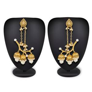 Unique Patterned Designer Earrings Set Is Here In Golden Color Beautified With White Pearl Work. This Can also Be Paired With Any Colored Traditional Attire.