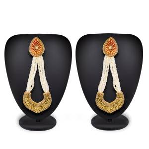 Simple, Rich And Elegant Looking Designer Pair Of Earrings Is Here In Golden Color With Stone And Moti. It Is Light Weight And Easy To Carry Throughout The Gala.