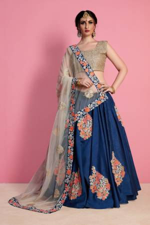 Grab This Designer Semi-Stitched Lehenga Choli In Beige Colored Blouse Paired With Dark Blue Colored Lehenga And Off-White Colored Dupatta. Its Blouse And Lehenga Are Fabricated On Art Silk Paired With Net Fabricated Dupatta. This Elegant Looking Lehenga Choli Will earn You Lots Of Compliments From Onlookers.
