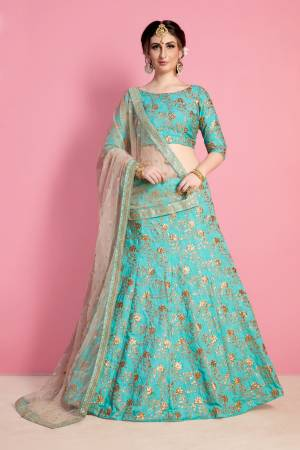 Earn Lots Of Compliments Wearing This Designer Trendy Lehenga Choli In Turquoise Blue Color Paireed With Beige Colored Dupatta. Its Blouse And Lehenga Are Fabricated On Art Silk Paired With Net Fabricated Dupatta. Its Lovely Color And Embroidery Will Give An Attractive Look Like Never Before.