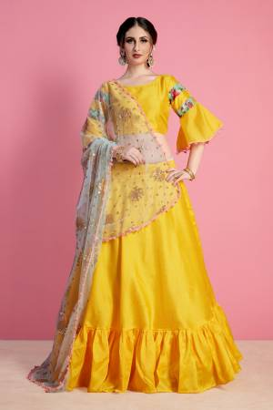 Bright And Appealing Color Is Here With This Designer Lehenga Choli In Yellow Color Paired With Contrasting Grey Colored Dupatta. Its Blouse And Lehenga Are Fabricated On Art Silk Paired With Net Fabricated Dupatta. Buy Simple Lehenga Choli With Attractive Dupatta.