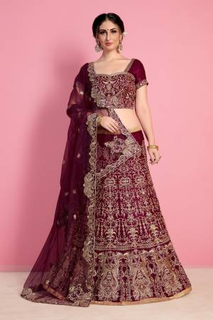 New And Unique Shade Is Here With This Designer Lehenga Choli In Wine Color Paired With Wine Colored Dupatta. This Legenga Choli Is Fabricated On Velvet Silk Paired With Net Fabricated Dupatta. Buy This Lehenga Choli Now.