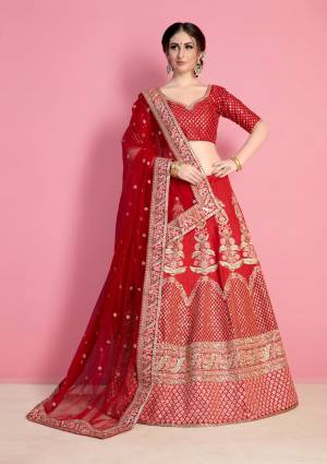 Adorn The Pretty Angelic Look Wearing This Designer Lehenga Choli In Red Color Paired With Red Colored Dupatta. This Bright Red Color And Its Embroidery Will Give Your Personality A Beautiful Look Like Never Before. Ts Blouse And Lehenga Are Fabricated On Art Silk Paired With Net Fabricated Dupatta.
