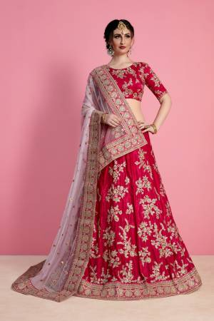 Look Attractive In This Designer Heavy Lehenga Choli In Dark Pink Color Paired With Light Pink Colored Blouse. This Blouse And Lehenga Are Fabricated On Velvet Silk Paired With Net Fabricated Dupatta. It Has Heavy Embroidery Over All Over It.