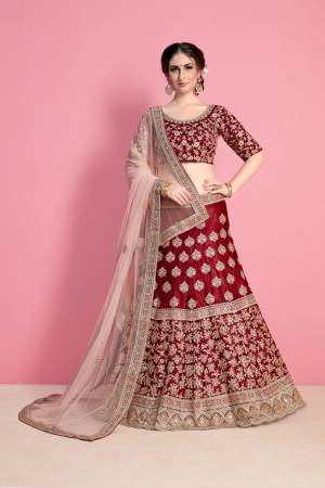 For A Royal Queen Like Look, Grab This Heavy Designer Lehenga Choli In Maroon Color Paired With Light Pink Colored Dupatta. Its Blouse And Lehenga Are Fabricated On Velvet Silk Paired With Net Fabricated Dupatta. Its All Over Heavy Embroidery And Pretty C