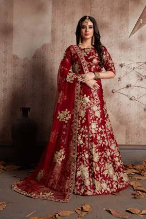This set features a maroon velvet dori work lehenga choli set. It comes along with lace work dupatta and heavy embroidery on dupatta's net. Matching blouse with heavy dori dori work.Looks completely heavy work.