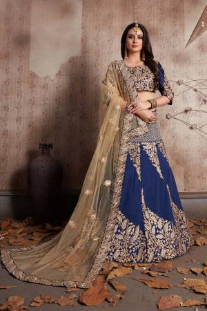 This set features a navy blue colour blouse in art silk base with zari and thread hibiscus leafs embroidery all over the front and back. It is paired with matching navy blue flared art silk lehenga appliqued with hibiscus embroidery all over the ghera.